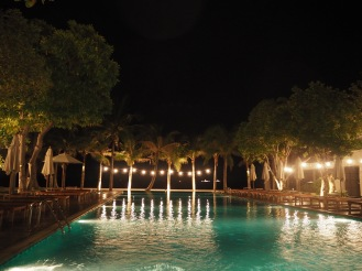The pool all lit up in the evenings