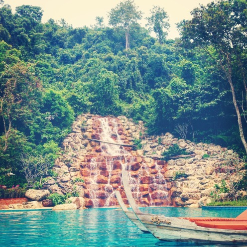 The beautiful pool and stunning waterfall