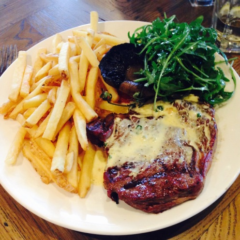 A delicious Rib eye with blue cheese sauce