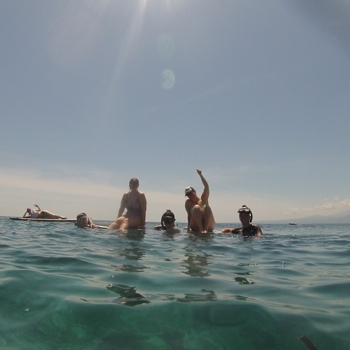 The gang resting on the paddle boards mid snorkel!