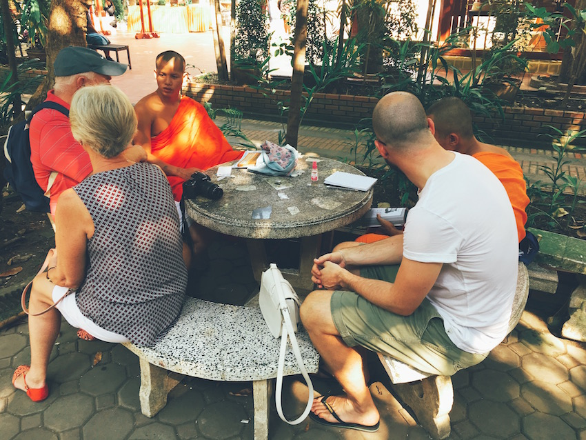 Chatting with novice monks at Wat Phra Singh