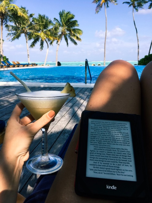 Relaxing by the pool with a cocktail